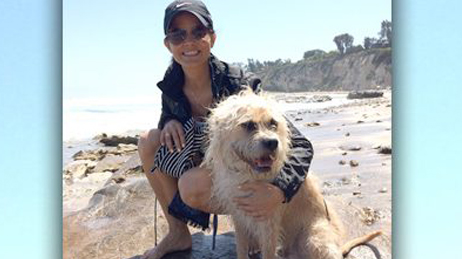 Lu Parker with dog at beach